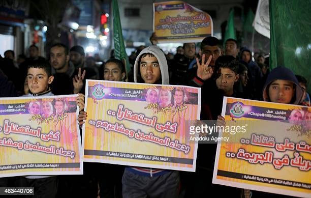 A group of Palestinians protest against the Chapel Hill shooting in Jabalia region in Gaza City Gaza on February 14 2015 Three young Muslim Students...