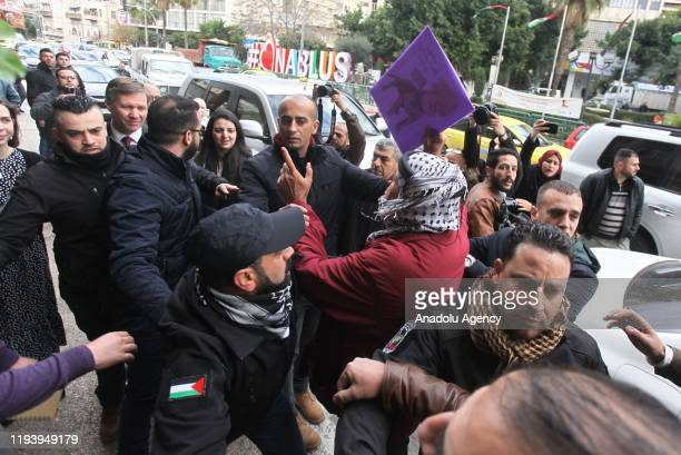 A group of Palestinians protest outside municipality building during British ConsulGeneral to Jerusalem Philip Hall's visit to Nablus West Bank on...