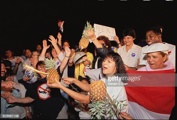 A group of Panamanians celebrate Manuel Noriega's surrender to US troops The United States invaded Panama in 1989 to bring leader Manuel Noriega back...