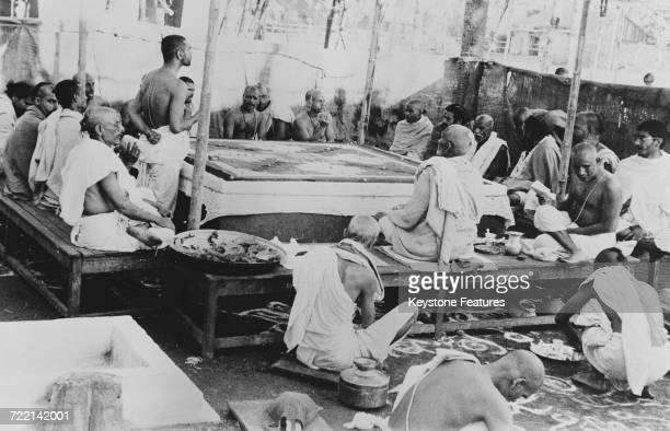 A group of Pandits performing initial rituals at a ceremony of prayer for world peace in Mumbai India February 1947 The worshippers have gathered to...