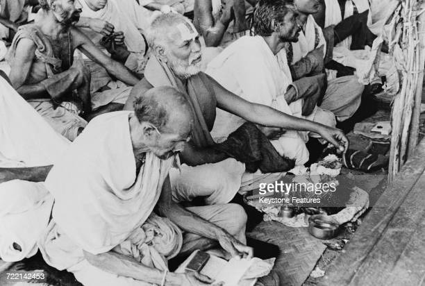 A group of Pandits reading Vedic scriptures at a ceremony of prayer for world peace in Mumbai India February 1947 The worshippers have gathered to...
