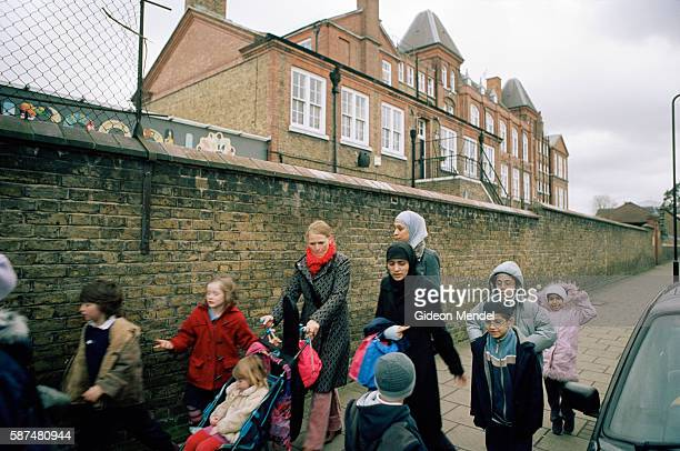 A group of parents and pupils leave Millfiedls Community School at the end of the school day This The is a large innercity primary school with 604...