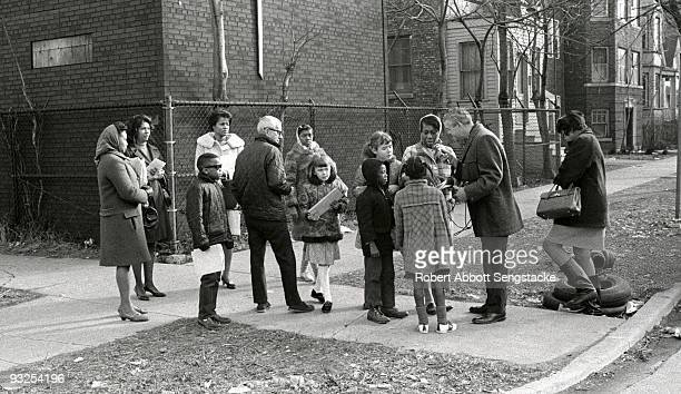 A group of parents and students from the West Side neighborhood of Austin gather on a street corner while participating in the school busing program...
