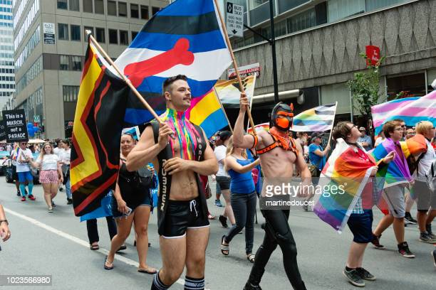 """group of participants of lgbtq pride parade in montreal. - """"martine doucet"""" or martinedoucet stock pictures, royalty-free photos & images"""
