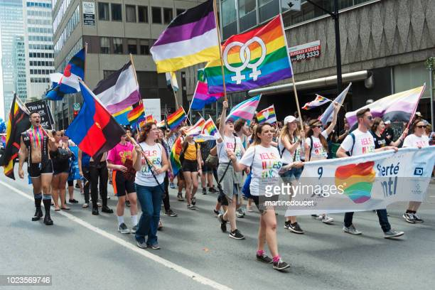 "group of participants of lgbtq pride parade in montreal. - ""martine doucet"" or martinedoucet stock pictures, royalty-free photos & images"