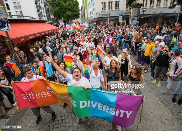 A group of participants walks over the Liebfrauenberg in Frankfurt am Main Germany 15 July 2017 Thousands of lesbians and gays take the streets at...