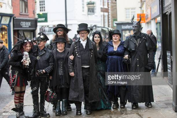 A group of participants with crossplay outfits being pictured in the town center The Whitby Goth Weekend alternative music festival began in 1994 and...