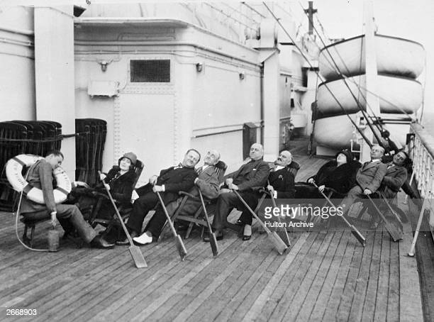Group of passengers amuse themselves on the deck of an ocean liner with a lifebelt and a few oars.