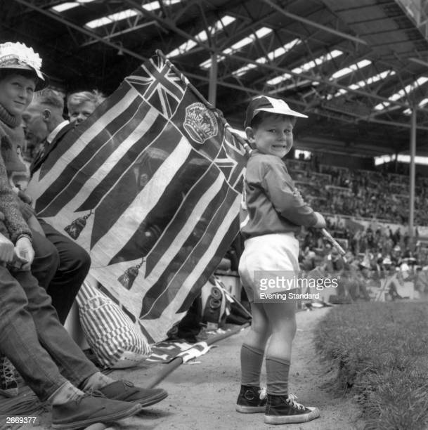 A group of patriotic young football fans watching the England team play at the World Cup Final against West Germany at Wembley Stadium London