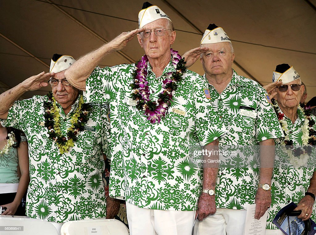 A group of Pearl Harbor survivors salute the flag during the beginning of the ceremony honoring the 64th anniversary of the surprise attack on Pearl Harbor December 7, 2005 at Pearl Harbor, Hawaii. Around the country, Pearl Harbor survivors and others paid tribute to those lost during the December 7, 1941 Japanese bombing of Pearl Harbor.