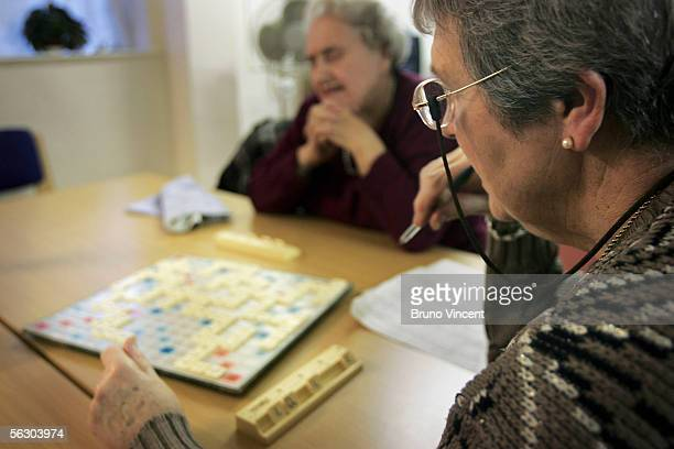 A group of pensioners play a game of scrabble at an Age Concern centre on November 30 2005 in London England The Chairman of the Pensions Commission...