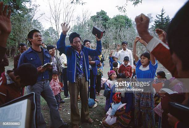 A group of Pentecostal Christians sing during an outdoor church service outside of Guatemala City Guatemala January 2 1982