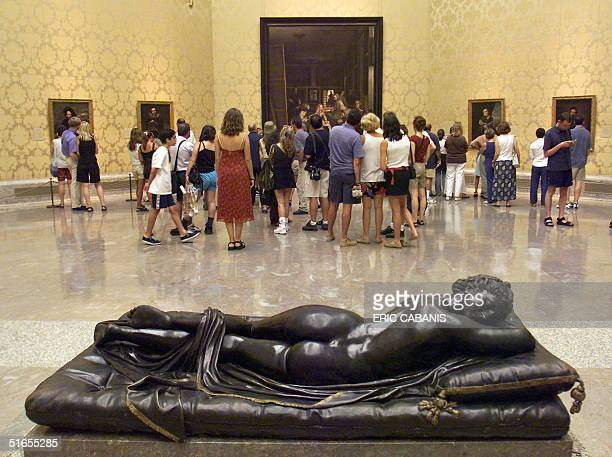 A group of people admire Las Meninas the famous 1656 work of Spanish painter Diego Velasquez at the Prado museum in Madrid 23 July 1999 as ew rooms...