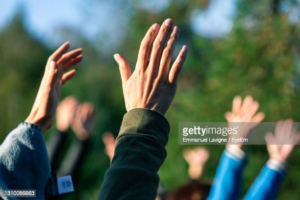group of people against blurred background - cult stock pictures, royalty-free photos & images
