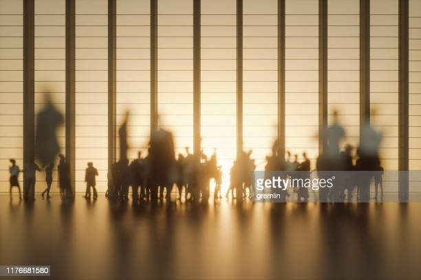 group of people against modern glass facade - persona in secondo piano foto e immagini stock