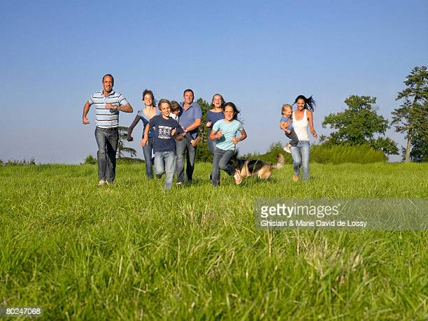 Group of people and children running.