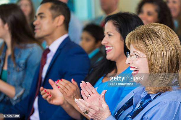 group of people applaud the speaker during meeting or seminar - town hall meeting stock photos and pictures