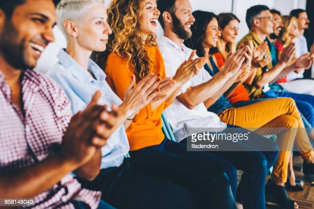 group of people applauding - press conference stock pictures, royalty-free photos & images