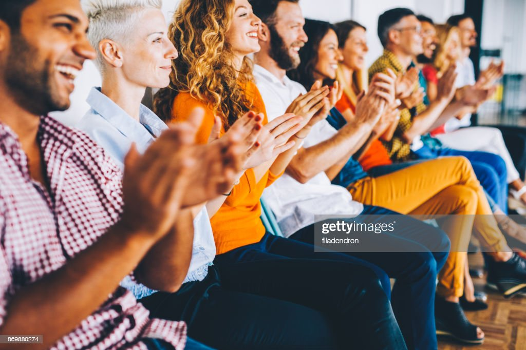 Group of people applauding : Stock Photo
