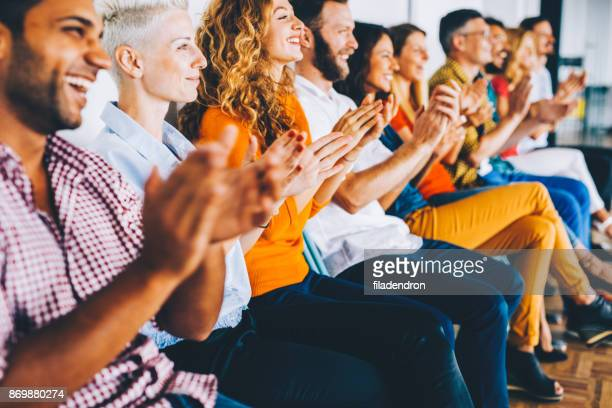 group of people applauding - conference stock pictures, royalty-free photos & images