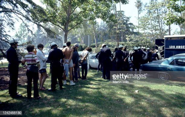 Group of people are arrested by Los Angeles Police officers during a student protest against President Richard Nixon's foreign policies involving the...