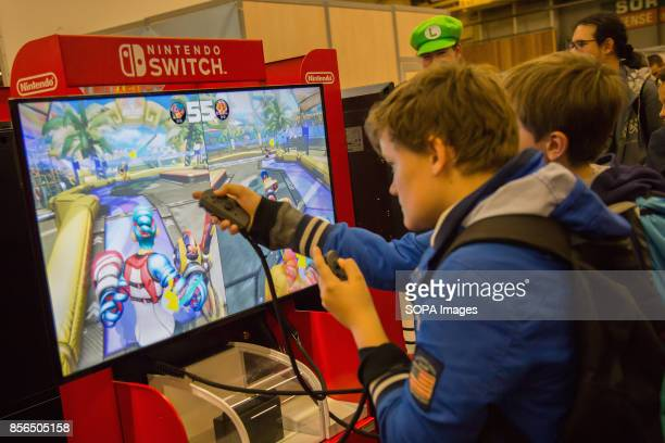 A group of people are pictured while playing 'Arms' Nintendo Switch video game during the 24th edition of the Paris Manga SciFi Show mostly devoted...