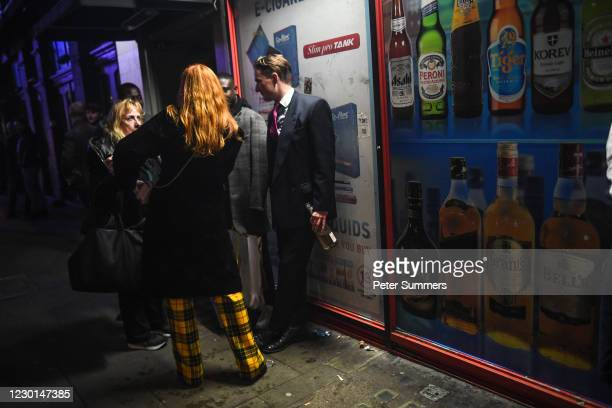Group of people are seen drinking in Soho, ahead of London being moved into Tier 3 of the pandemic-control system on Wednesday, on December 15, 2020...