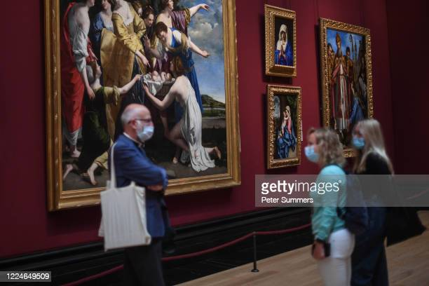Group of people are seen wearing masks while viewing paintings at the National Portrait Gallery during a press preview ahead of the gallery's...