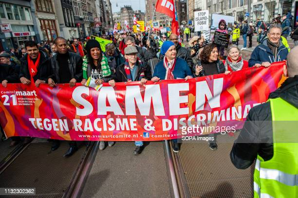 A group of people are seen with the principal banner during the demonstration Thousands of people gathered at the Dam square in the center of...