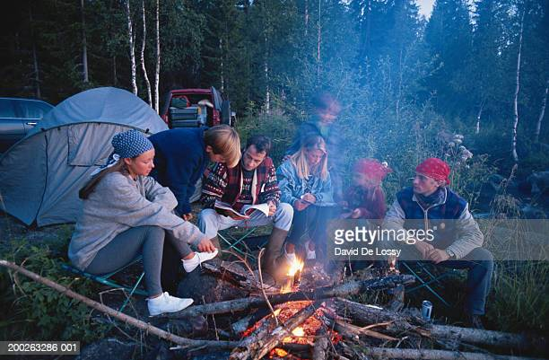 Group of people around camp fire