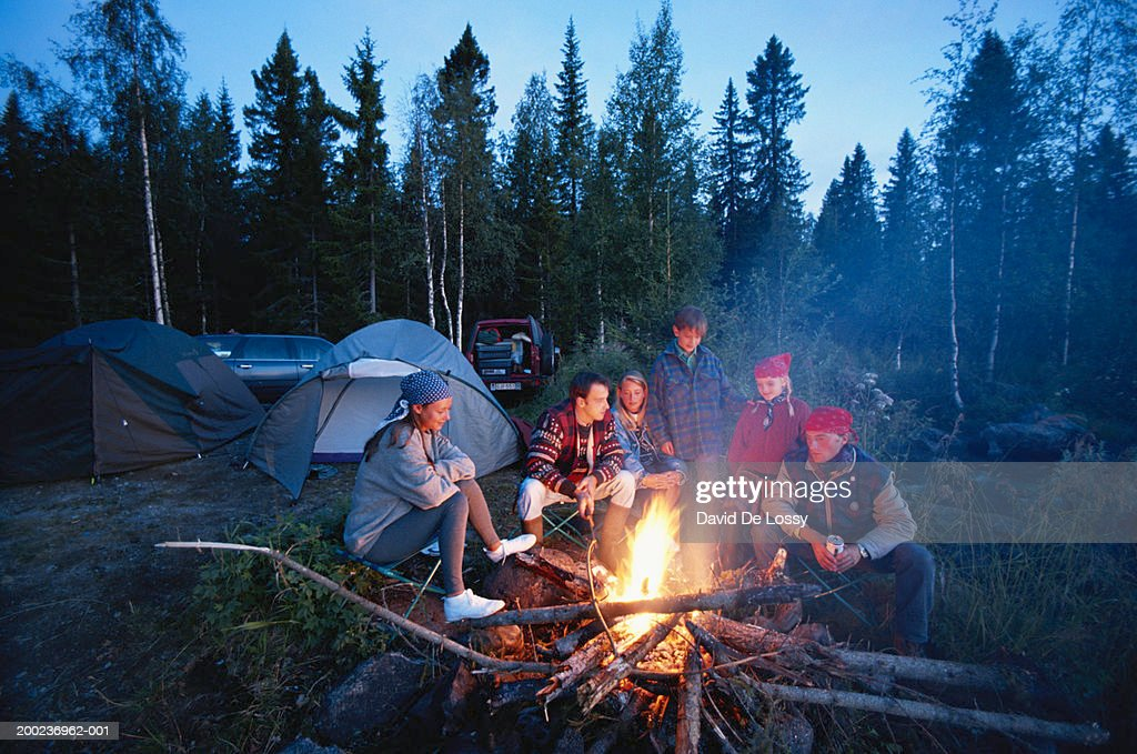 Group of people around campfire : Stock Photo