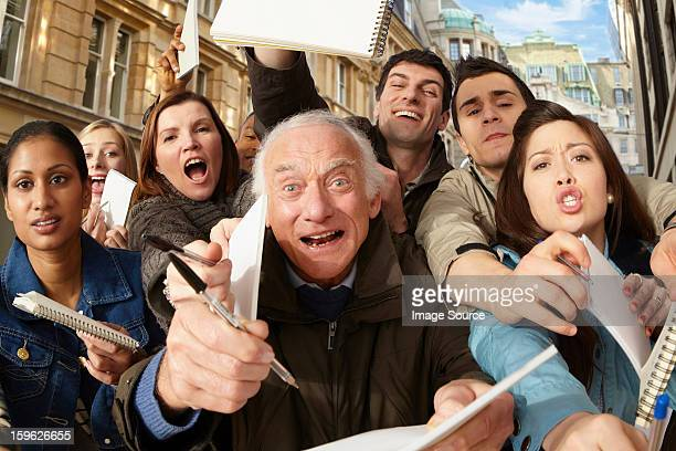 group of people asking for autographs - autographs stock photos and pictures