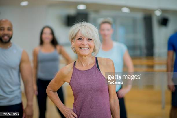 group of people at a fitness center - center athlete stock pictures, royalty-free photos & images