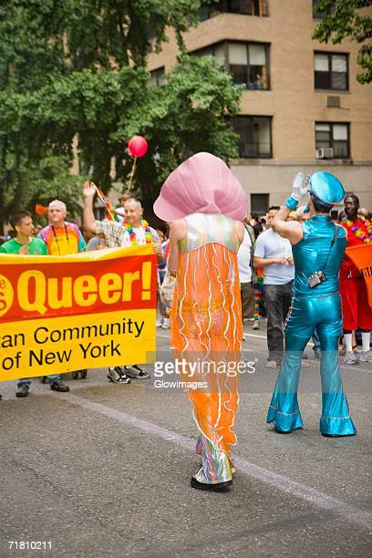 group of people at a gay parade - parade stock pictures, royalty-free photos & images