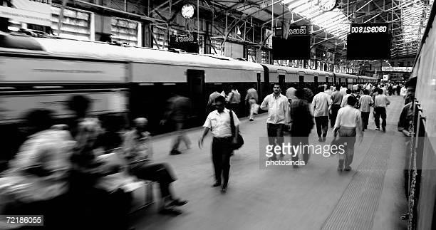 Group of people at a railway station, Churchgate Station, Mumbai, Maharashtra, India