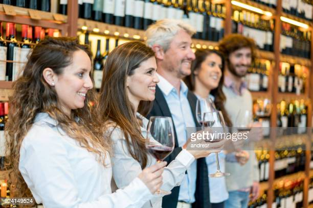 group of people at a wine tasting looking away very happy - bar drink establishment stock photos and pictures