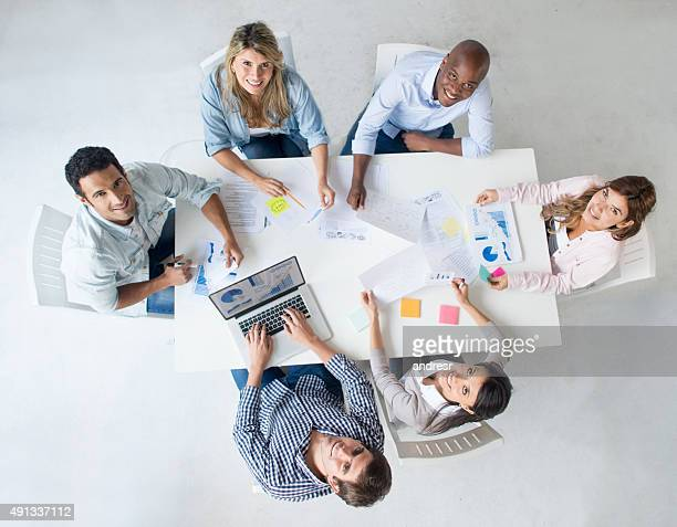 Group of people at business meeting at a creative office