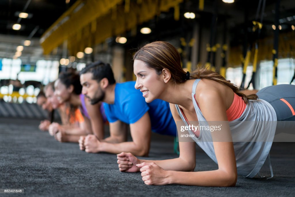 Group of people at the gym in a suspension training class : Stock Photo