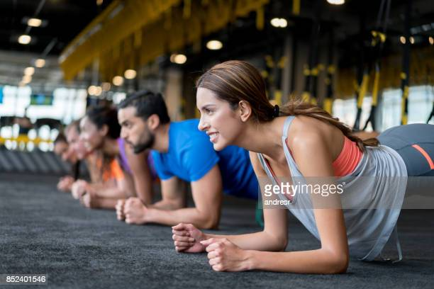 group of people at the gym in a suspension training class - manufactured object stock pictures, royalty-free photos & images