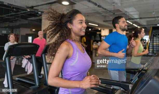 Group of people at the gym running on the treadmills