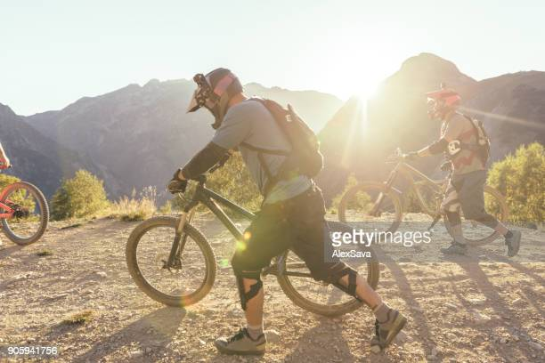 Group of people backcountry mountain biking in Les Deux Alps