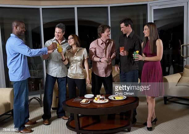 group of people celebrating in hotel room, having drinks - cocktail party stock pictures, royalty-free photos & images