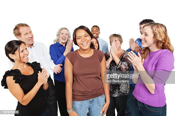 Group of People Cheering For a Friend
