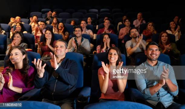 group of people clapping at the theater - audience stock pictures, royalty-free photos & images