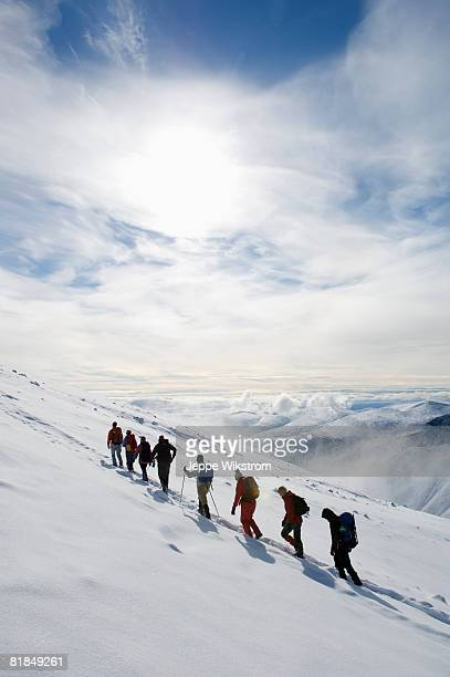 a group of people climbing kebnekaise sweden. - norrbotten province stock photos and pictures