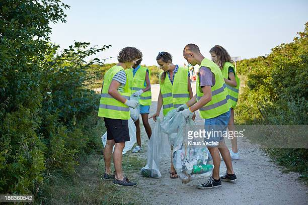 Group of people collecting trash in the nature