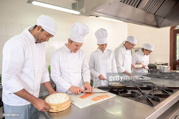 Group of people cooking at a restaurant