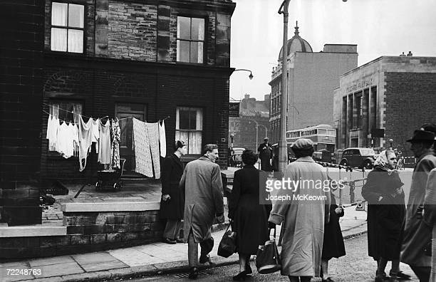 A group of people crossing the street in Leeds May 1955 Original Publication Picture Post 8067 The Importance of Being Yorkshire unpub