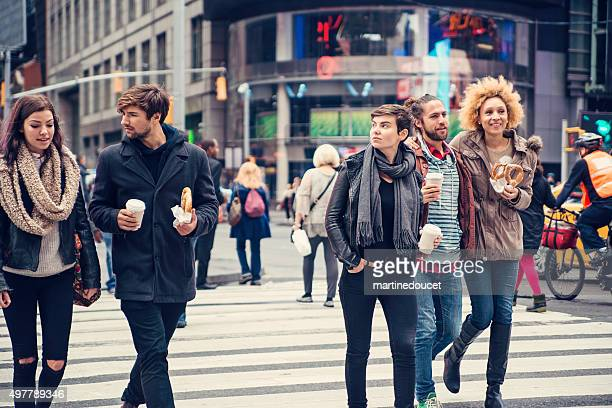 Group of people crossing the street in New York.