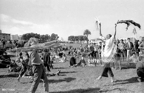 A group of people dance around in Dolores Park circa April 1969 in San Francisco California